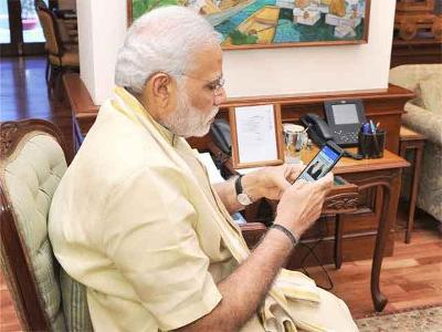 pm modi manage his twitter and facebook himself?