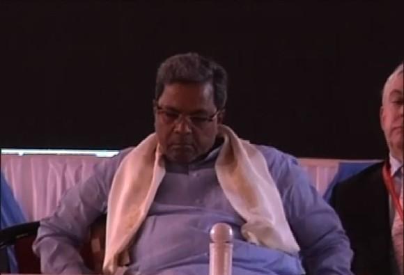 CM Siddaramaiah sleeps during Modi's speech