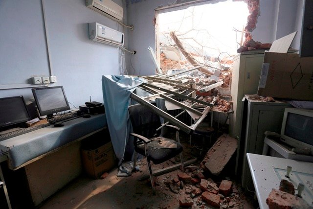 China hospital bulldozed with doctors, nurses, patients inside