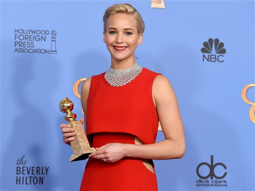 """Jennifer Lawrence poses in the press room with the award for best performance by an actress in a motion picture - musical or comedy for """"Joy"""" at the 73rd annual Golden Globe Awards on Sunday, Jan. 10, 2016, at the Beverly Hilton Hotel in Beverly Hills, Calif. (Photo by Jordan Strauss/Invision/AP)"""
