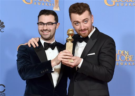 """Jimmy Napes, left, and Sam Smith pose in the press room with the award for best original song in a motion picture for """"Writing's on the Wall"""" from """"Spectre"""" at the 73rd annual Golden Globe Awards on Sunday, Jan. 10, 2016, at the Beverly Hilton Hotel in Beverly Hills, Calif. (Photo by Jordan Strauss/Invision/AP)"""