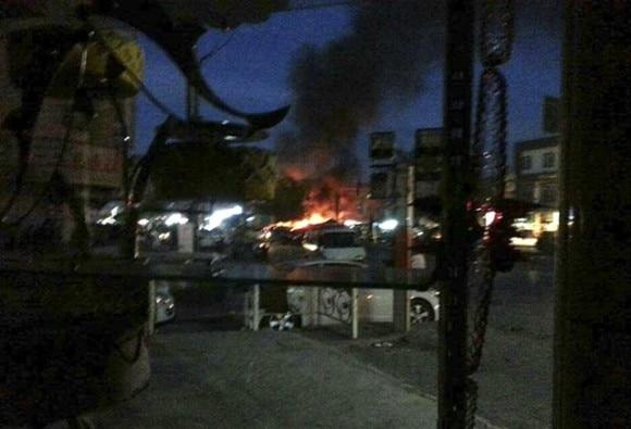 Baghdad mall attack: Gunmen kill at least 18