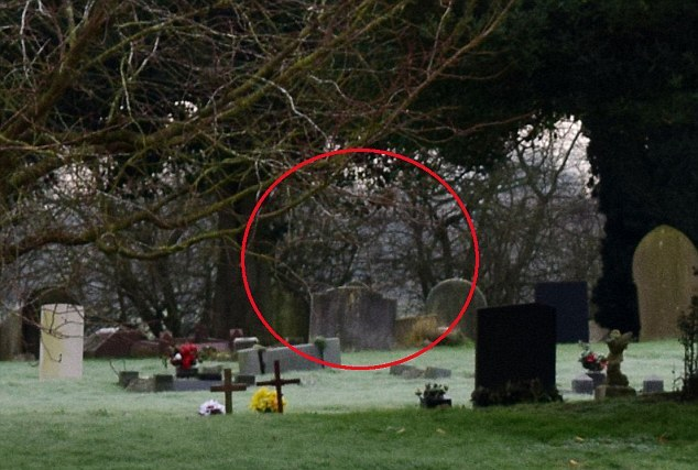 Photographer captures image of 'Grim Reaper' in a cemetery