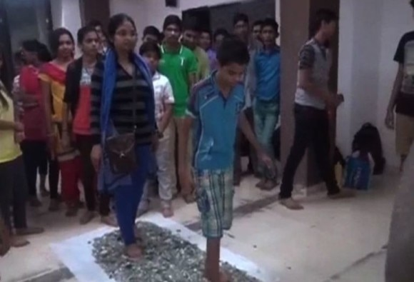Tuition teacher forces students to walk through broken glass