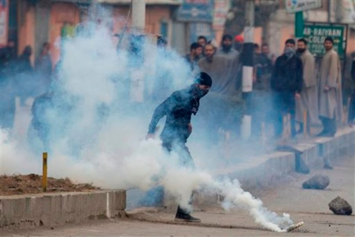 Protesters clash with police after body of youth found
