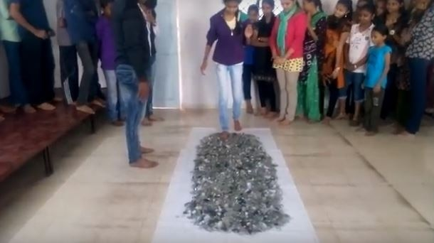 students made walk barefoot on broken glass in gujrat