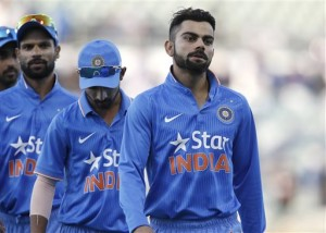 India's Virat Kohli, right, walks off the ground with teammates after being defeated by Australia in their one day international cricket match in Perth, Australia, Tuesday, Jan. 12, 2016. (AP Photo/Theron Kirkman)