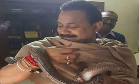 Bihar minister photos with snakes go viral