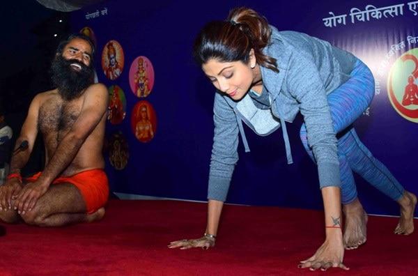 Shilpa Shetty doing Yoga with Baba Ram Dev