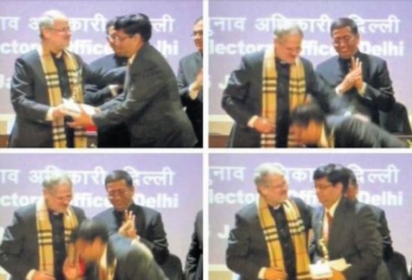 Delhi officer touches L-G's feet at event