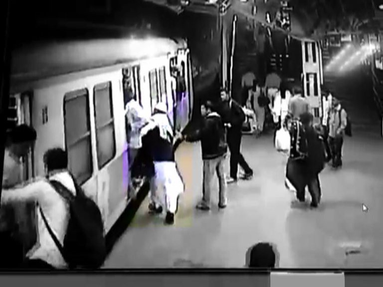 man crushed under moving local train