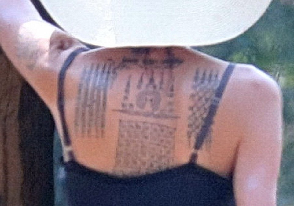 Angelina Jolie, 40, debuts THREE new tattoos on her back