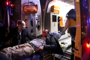 Paramedics carry a wounded man from the site of an explosion into an ambulance in Ankara, Wednesday, Feb. 17, 2016. Assailants on Wednesday exploded a car bomb near vehicles carrying military personnel in the Turkish capital, killing at least 18 people and wounding some 45 others, officials said. (Mustafa Kirazli/Cihan News Agency via AP) TURKEY OUT