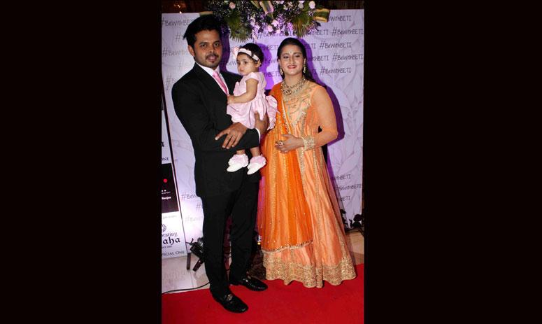 Indian former cricket player S Sreesanth with his wife Bhuvaneshwari Kumari and daughter Sree Sanvika during the fashion show organised by Beti Foundation in Mumbai