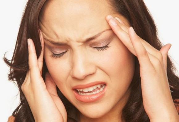 What components of wine might cause headaches and upset stomach?