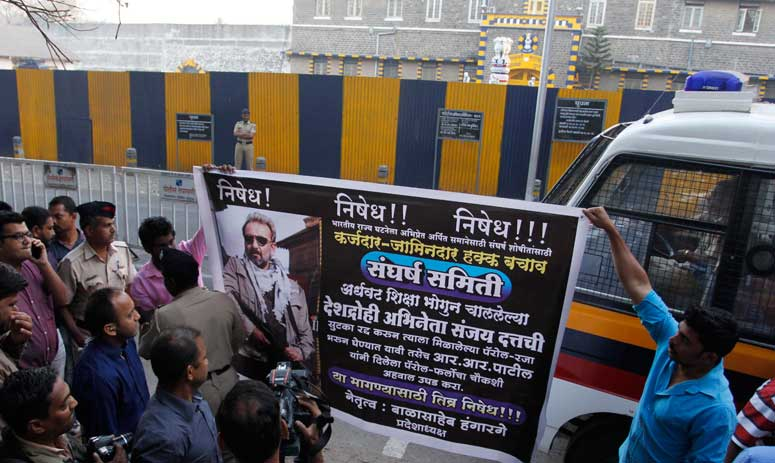 People protest against the early release of Bollywood actor Sanjay Dutt outside Yerawada Central Jail