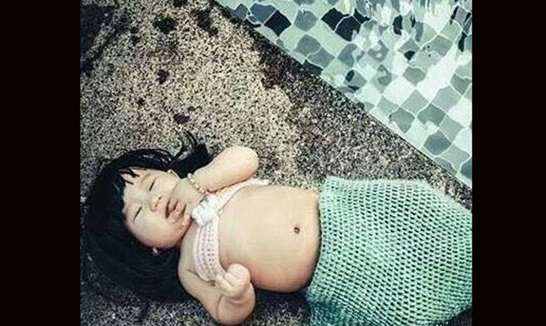 picture of an adorable girl dressed in mermaid costume gone viral