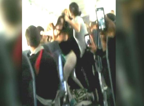 Female plane passengers filmed fighting over loud music on flight
