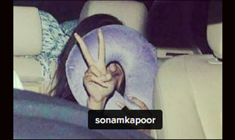 jacqueline and sonam hide their faces when they face the camera