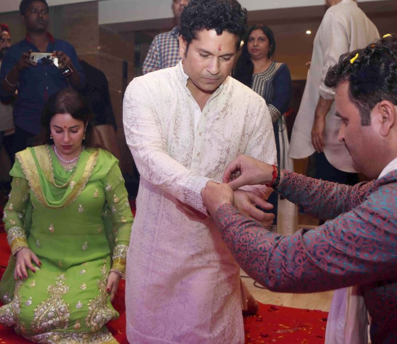 Bollywood music composer Anu Mallik with former Indian cricket player Sachin Tendulkar and Anjali Tendulkar during his annual Jagrata