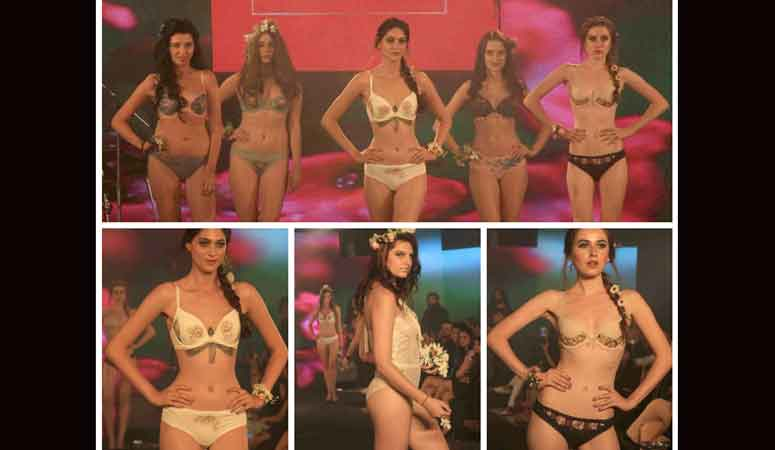 Models display the creation of fashion brand Triumph during the India Intimate Fashion Week, in Mumbai