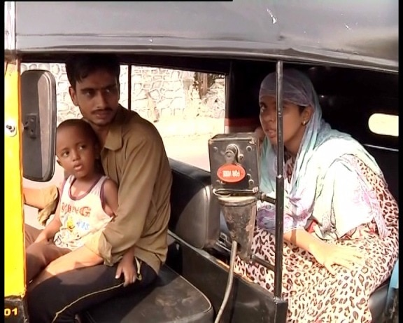 The wife's hands and feet are lifeless, so the auto driver is playing the responsibility of both the mother and father