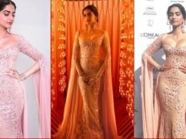 Cannes2017: बला की खूबसूरती लिए पिंक ड्रेस में रेड कार्पेट पर दिखीं सोनम कपूर, आप भी देखें तस्वीरें