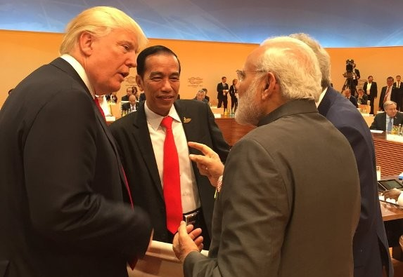 HAMBURG: US President Donald Trump walks up to Indian Prime Minister Narendra Modi for 'impromptu' chat at G20 Summit