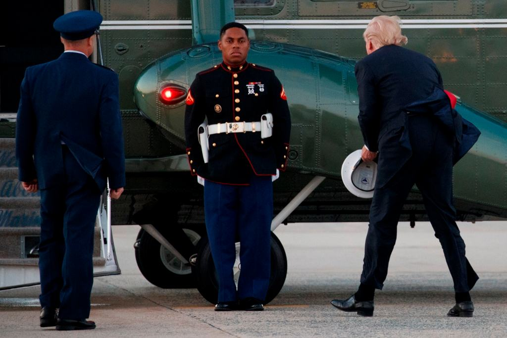 Trump stopping to pick up Marine's hat blown away by wind is president's latest viral moment