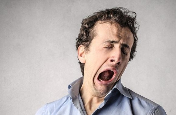 Are you a serial yawner at work? You might be just making everyone lazy