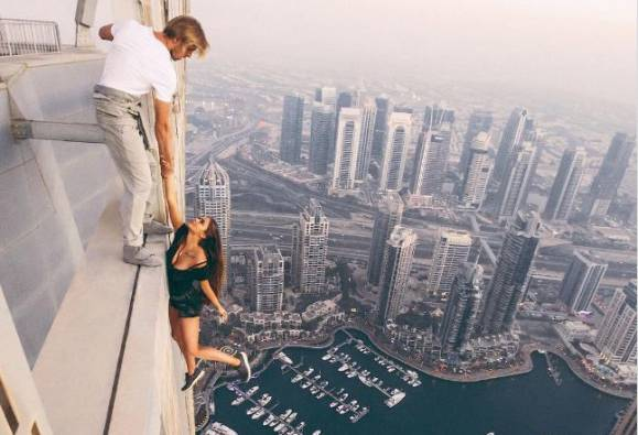 Russian model dangles from Cayan Tower in Dubai