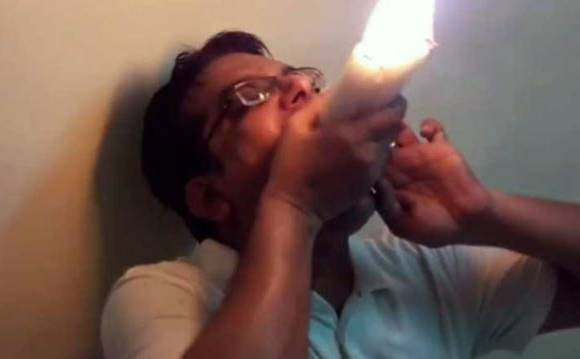 Dinesh upadhyay Most Lit Candles Held In The Mouth