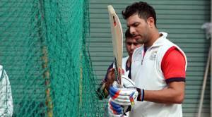 Player of Punjab Ranji Team Yuvraj Singh giving tips to Manan Vohra during net practice at PCA Stadium in Mohali on Tuesday, January 27 2015. Express photo by Jasbir Malhi