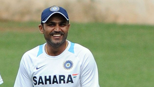 Virender-Sehwag-R-of-India-shares-a-joke-with-teammate-during-an-Indian-nets-session-at-M