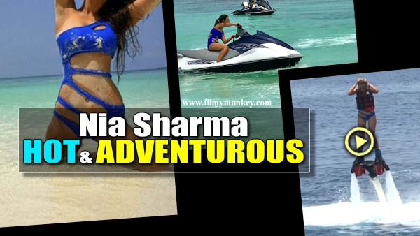 Hot Nia Sharma clad in a blue bikini turns daredevil in Maldives, goes water hoverboarding & Jet Skiing!