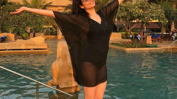 PICS: TV HOTTIE Karishma Tanna CHILLS in pool with her GIRL GANG!