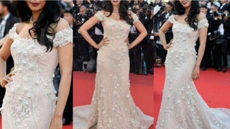 CANNES 2017: IN PICS- After Deepika Padukone, Mallika Sherawat impresses at the RED CARPET; Bollywood bombshell looks ravishing in an embellished ivory trailed gown!