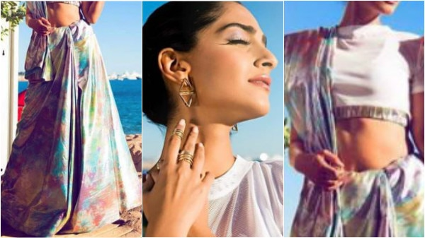 Cannes 2017: Fashionista Sonam Kapoor makes her first appearance looking RAVISHING as ever in a prismatic saree!