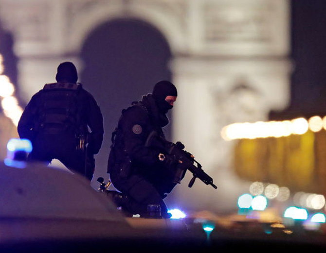 3-Paris attack police officer and suspect shot dead on Champs Elysees in attack