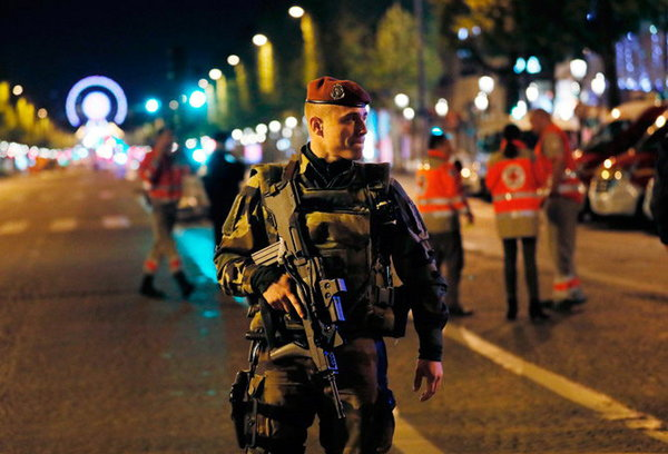4-Paris attack police officer and suspect shot dead on Champs Elysees in attack