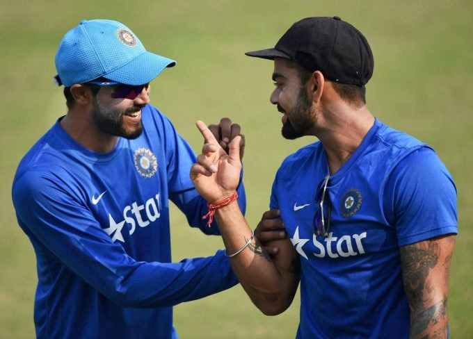 india-s-virat-kohli-share-a-light-moment-with-ravindra-jadeja-during-a-practice-session_144663427340