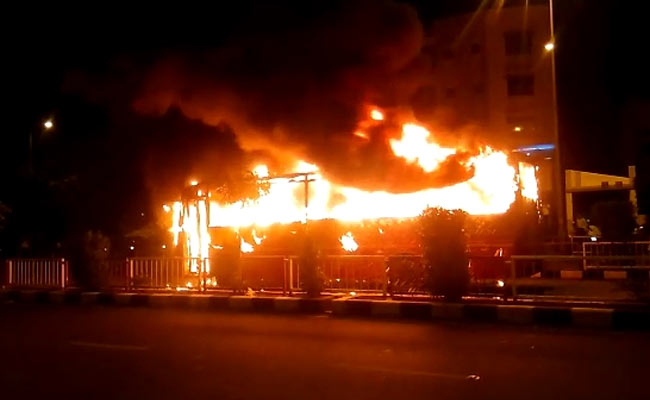 0-2 buses torched in surat after police detain dozen patidar protesters