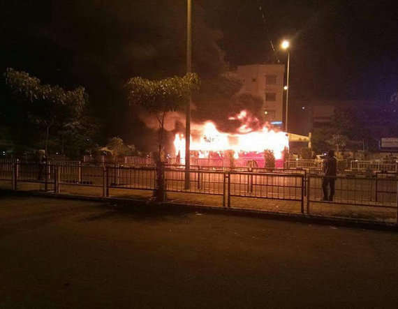 7-2 buses torched in surat after police detain dozen patidar protesters