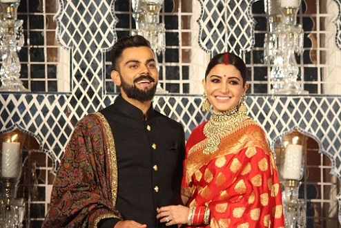 0-virat anushkas wedding recpection dress design by sabyasachi mukherjee
