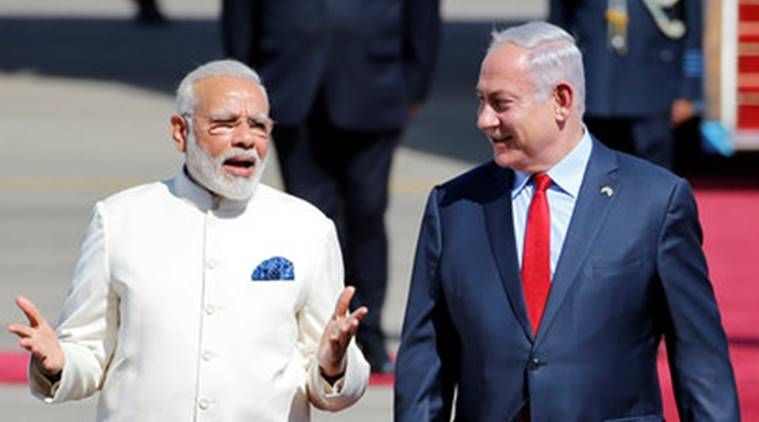 Israeli Prime Minister Benjamin Netanyahu welcomes Indian Prime Minister Narendra Modi during an official welcoming ceremony upon his arrival to Israel at Ben Gurion Airport, near Tel Aviv