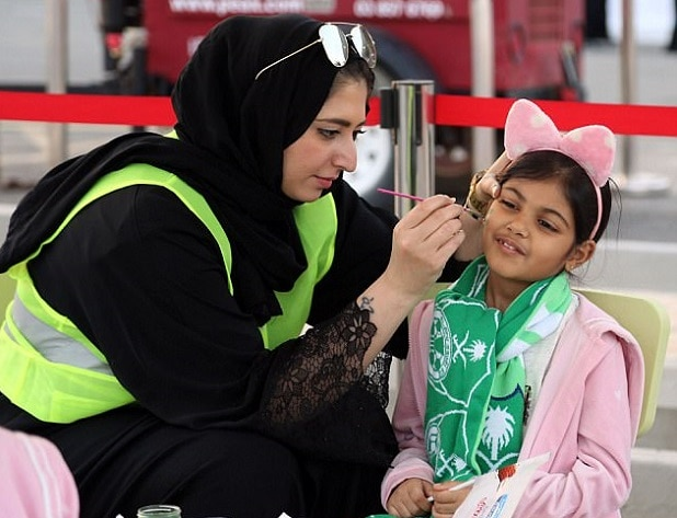 4-saudi women enter stadium for first time to watch soccer