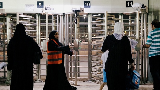 13-saudi women enter stadium for first time to watch soccer