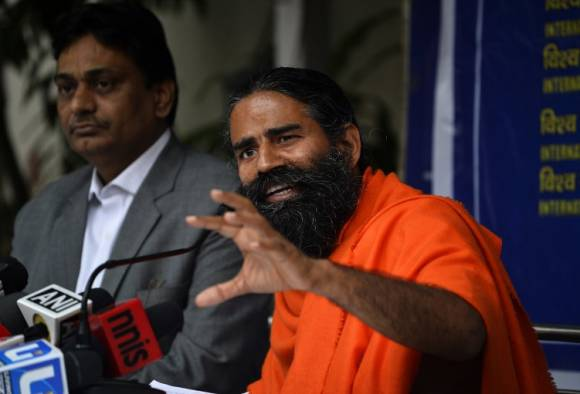 Congress charges Ramdev with a role in rebellion by party MLAs in Uttarakhand