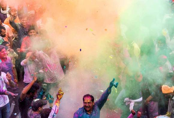 Colours fill the air as India celebrates Holi